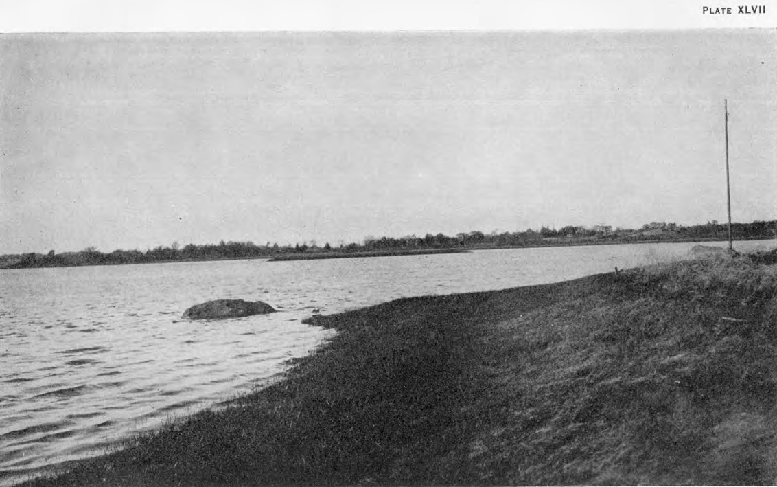 BROWN PHOTOGRAPH OF DIGHTON ROCK AS SEEN FROM THE SHORE, 1915